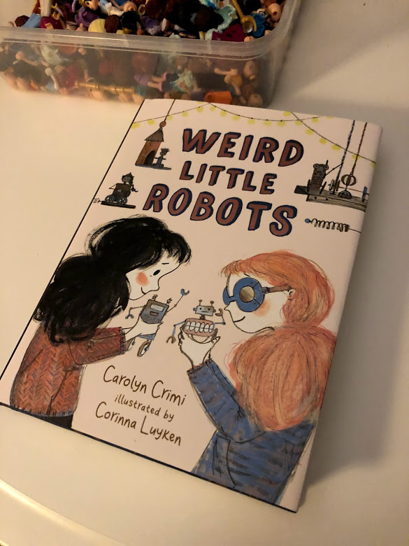 Weird Little Robots - Cover (plus my daughter's collection of dismembered lego minifigs)