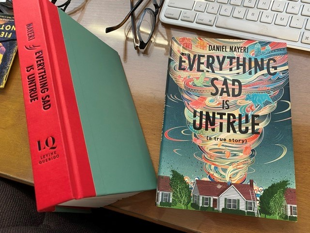 Everything Sad Is Untrue, both the unjacketed book and the dust jacket, separate, on my desk
